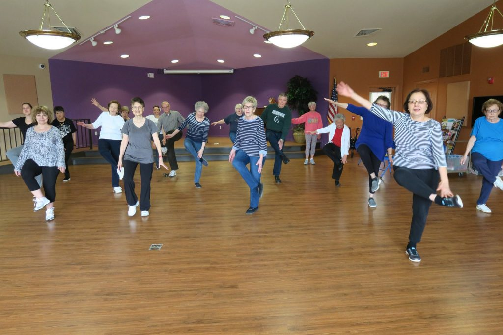 Adults doing an aerobics class.