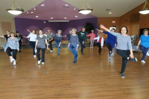 Adults dancing during a fitness class with Leisure Unlimited.